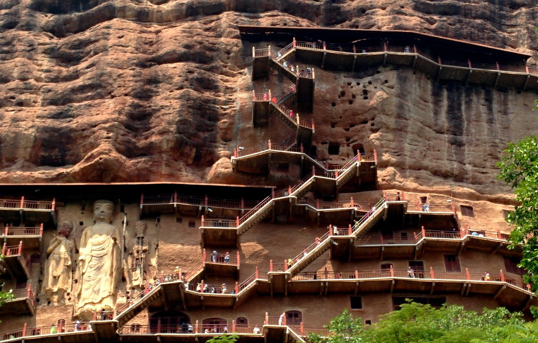 Tianshui China  city pictures gallery : Tianshui, China: Climbing Maijishan Cliff face Grottoes Elvis ...